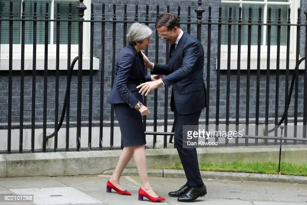 British Prime Minister Theresa May greets Prime Minister of the Netherlands Mark Rutte outside Downing Street on February 21 2018 in London England...