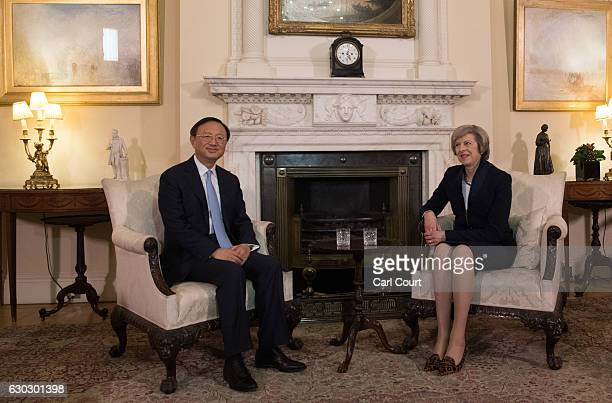 British Prime Minister Theresa May greets State Councillor of the People's Republic of China Yang Jiechi in 10 Downing Street on December 20 2016 in...