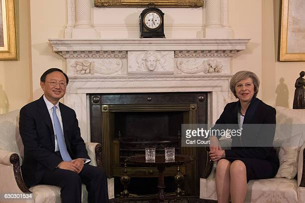 British Prime Minister Theresa May greets State Councillor of the People's Republic of China Yang Jiechi in 10 Downing Street on December 20, 2016 in...