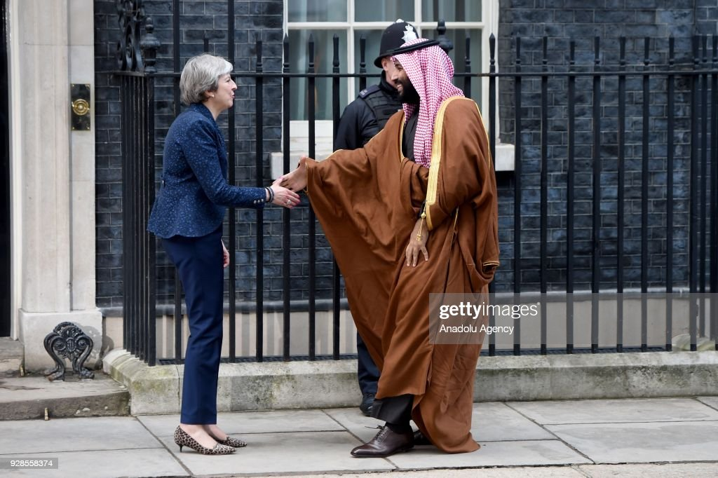 British Prime Minister Theresa May (L) greets The Crown Prince of Saudi Arabia Mohammad bin Salman al-Saud (R) on the steps of No.10 Downing Street, as he arrives for a meeting in London, United Kingdom on March 07, 2018.