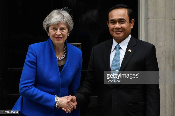 The Prime Minister of Thailand Prayut Chanocha waves to the media as he prepares to meet his British counterpart Theresa May at Downing Street on...