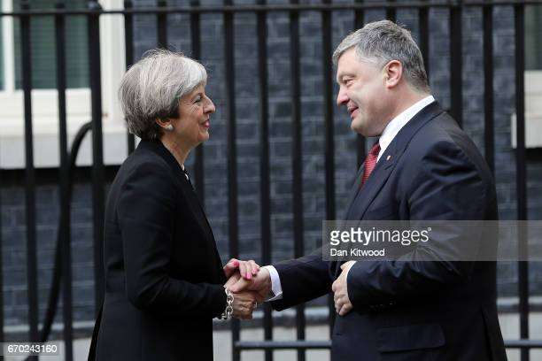 British Prime Minister Theresa May greets Ukrainian President Petro Poroshenko in Downing Street on April 19 2017 in London United Kingdom Mrs May...