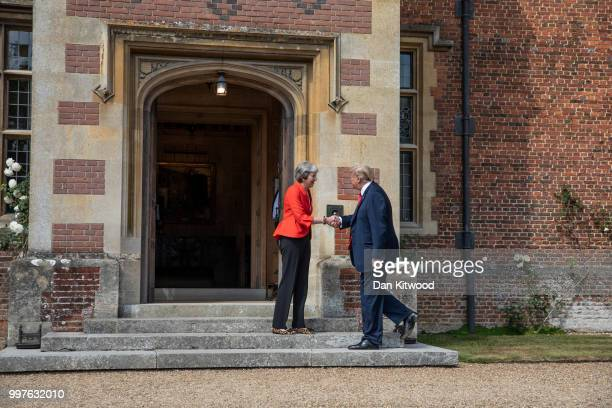 British Prime Minister Theresa May greets US President Donald Trump at Chequers on July 13 2018 in Aylesbury England US President Donald Trump held...