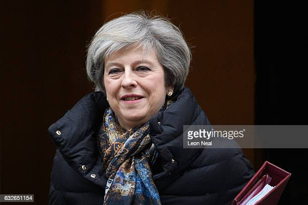 British Prime Minister Theresa May heads to the weekly PMQ session in the House of Commons after leaving number 10 at Downing Street on January 25...