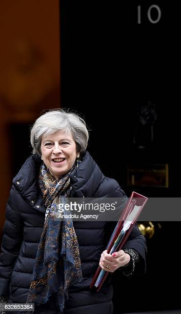British Prime Minister Theresa May heads to the weekly Prime Minister's Questions session in the House of Commons after leaving number 10 Downing...
