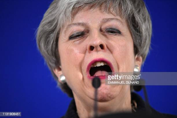 British Prime Minister Theresa May holds a press conference on March 22 on the first day of an EU summit focused on Brexit in Brussels European Union...