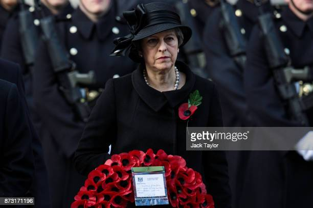 British Prime Minister Theresa May holds a wreath during the annual Remembrance Sunday memorial on November 12 2017 in London England The Prince of...