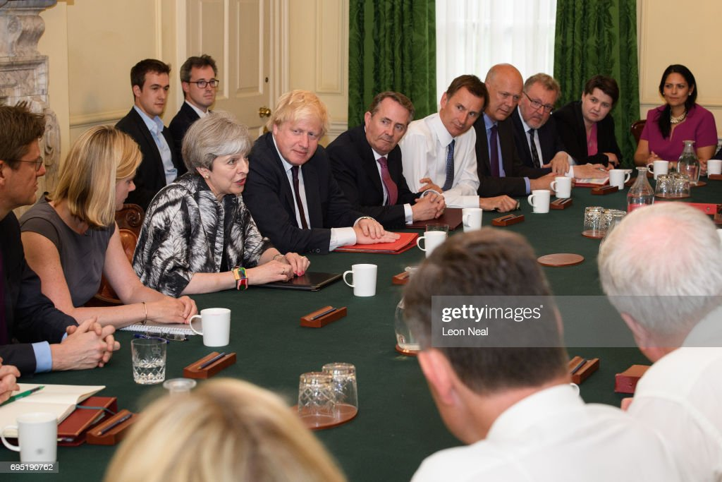 British Prime Minister Theresa May (3rd L) holds the first Cabinet meeting of her new team at 10 Downing Street on June 12, 2017 in London, England. The Cabinet met for the first time today after being reshuffled by British Prime Minister Theresa May following the Conservatives failing to achieve a majority during last week's general election.