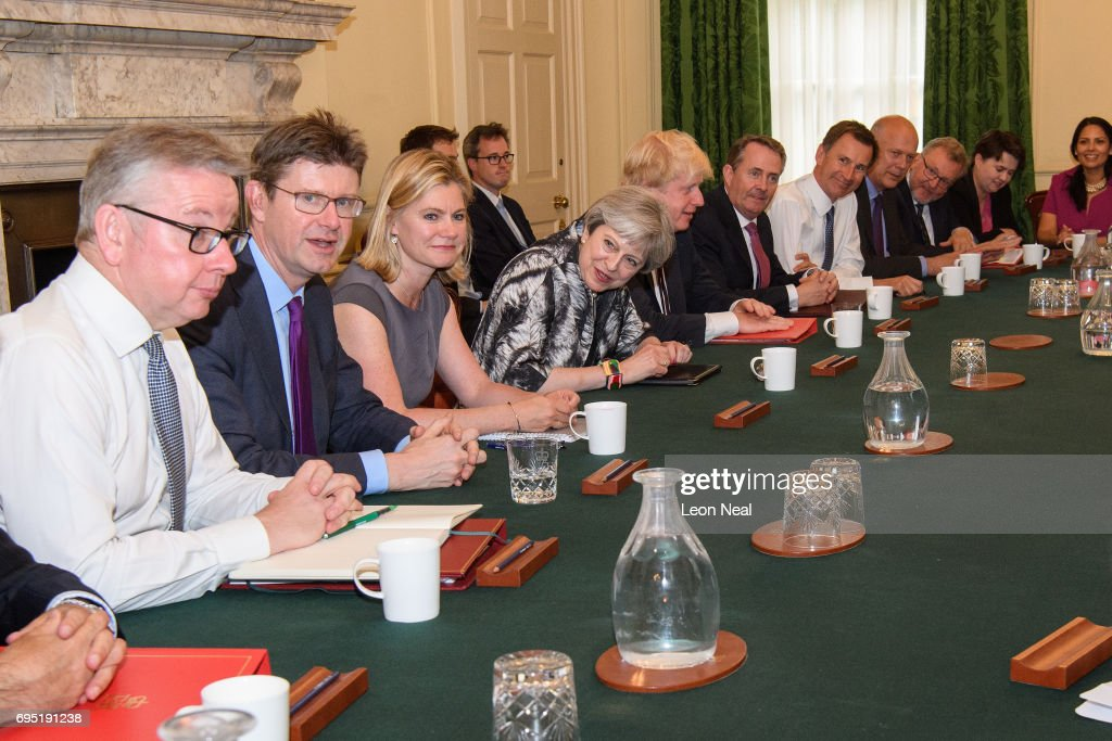 British Prime Minister Theresa May (4L) holds the first Cabinet meeting of her new team at 10 Downing Street on June 12, 2017 in London, England. The Cabinet met for the first time today after being reshuffled by British Prime Minister Theresa May following the Conservatives failing to achieve a majority during last week's general election.