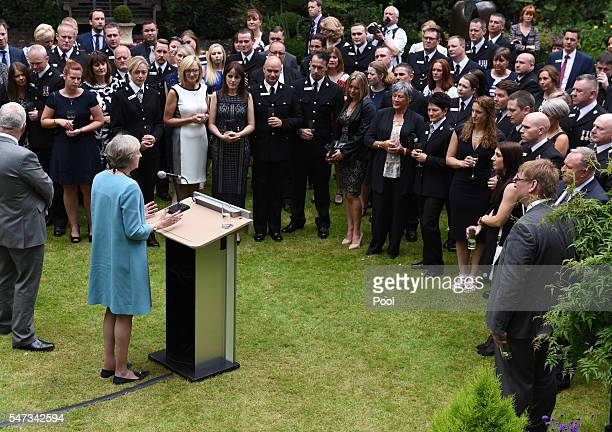 British Prime Minister Theresa May hosts a reception for the Police Bravery Awards in the Garden of Number 10 Downing Street on July 14 2016 in...