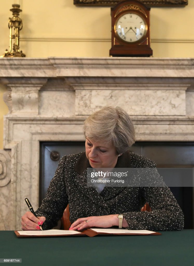 The Prime Minster Of the United Kingdom Theresa May Signs Article 50 : News Photo