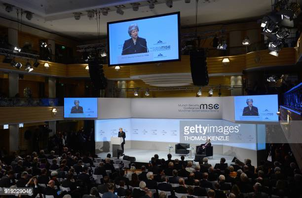 British Prime Minister Theresa May is being displayed on giant screens as she gives a speech during the Munich Security Conference on February 17...