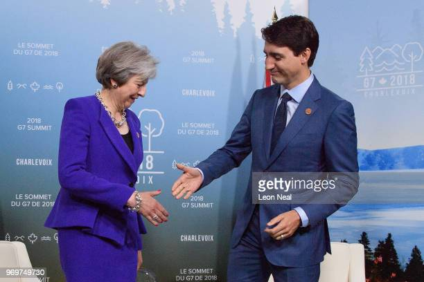 British Prime Minister Theresa May is greeted by Canadian Prime Minister on the first day of the G7 Summit on 8 June 2018 in La Malbaie Canada Canada...