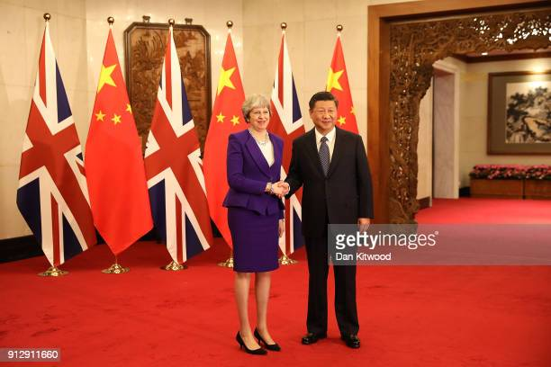British Prime Minister Theresa May is greeted by Chinese President Xi Jinping at Mr Jinping's official state guesthouse on February 1 2018 in Beijing...