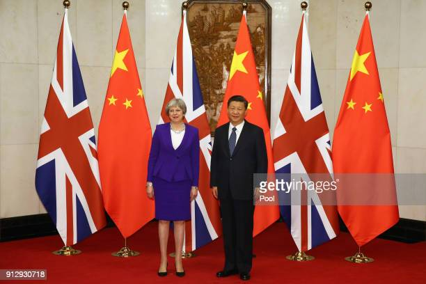 British Prime Minister Theresa May is greeted by Chinese President Xi Jinping at Mr Jinping's official Diaoyutai State Guesthouse on February 1 2018...