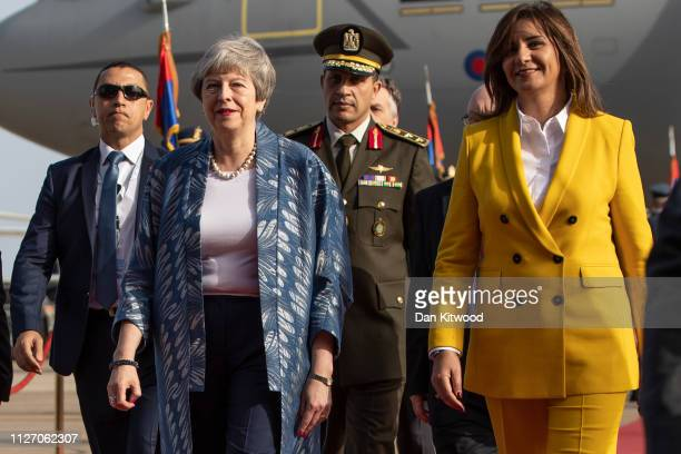 British Prime Minister Theresa May is greeted by Nabila Makram Minister of Immigration and Egyptian Expatriates Affairs for the first ArabEuropean...