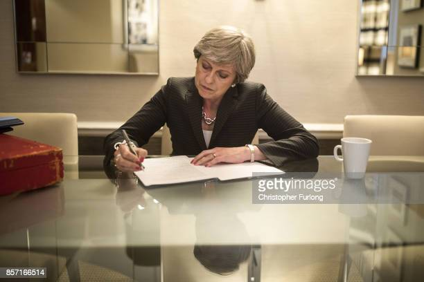 British Prime Minister Theresa May is pictured in her hotel room as she prepares her conference speech that she will deliver to her party's annual...