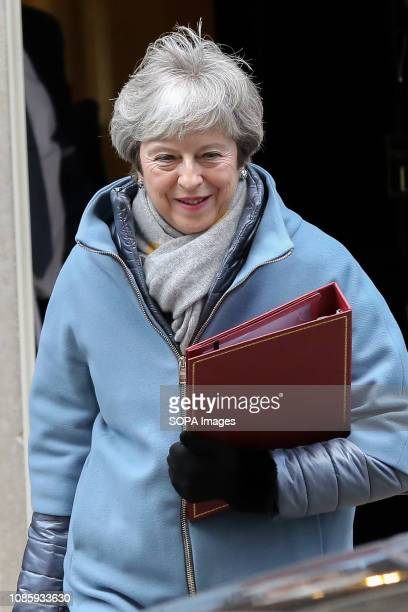 British Prime Minister Theresa May is seen departing from Number 10 Downing Street to make a statement in the House of Commons on an alternative...