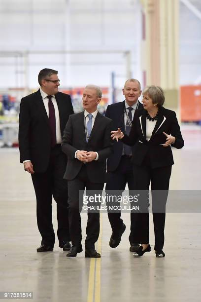 British Prime Minister Theresa May is shown around by Michael Ryan president of Bombardier Aerostructures and Engineering services division during a...