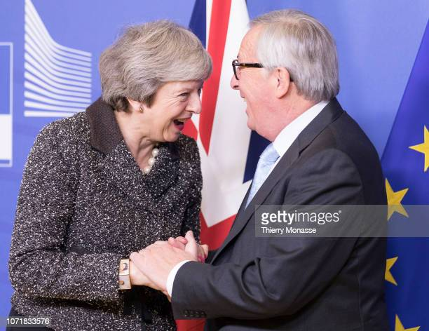 British Prime Minister Theresa May is welcome by the President of the EU Commission Jean-Claude Juncker for talks, in the Berlaymont, the European...