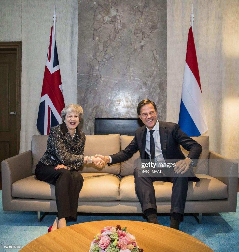 Maurits Hendriks Netherlands Prime Minister Mark Rutte L: British Prime Minister Theresa May Is Welcomed By Dutch