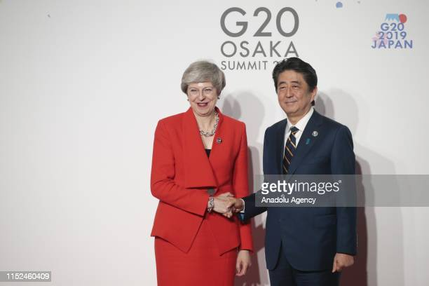 British Prime Minister Theresa May is welcomed by Japanese Prime Minister Shinzo Abe upon her arrival at the G20 Summit in Osaka, Japan on June 28,...
