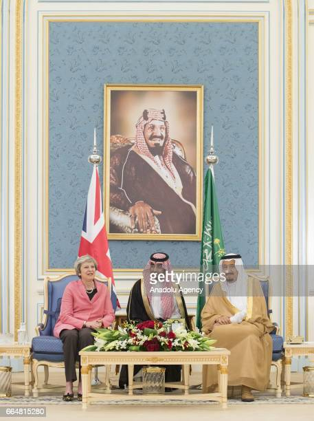 British Prime Minister Theresa May is welcomed by Saudi Arabia's King Salman bin Abdulaziz Al Saud at AlYamamah Palace in Riyadh Saudi Arabia on...