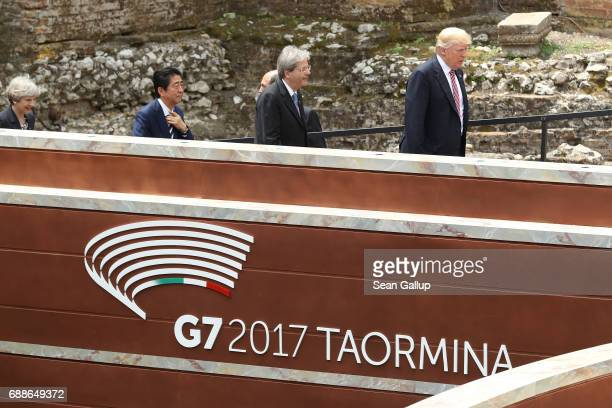 British Prime Minister Theresa May Japanese Prime Minister Shinzo Abe Italian Prime Minister Paolo Gentiloni and US President Donald Trump arrive for...