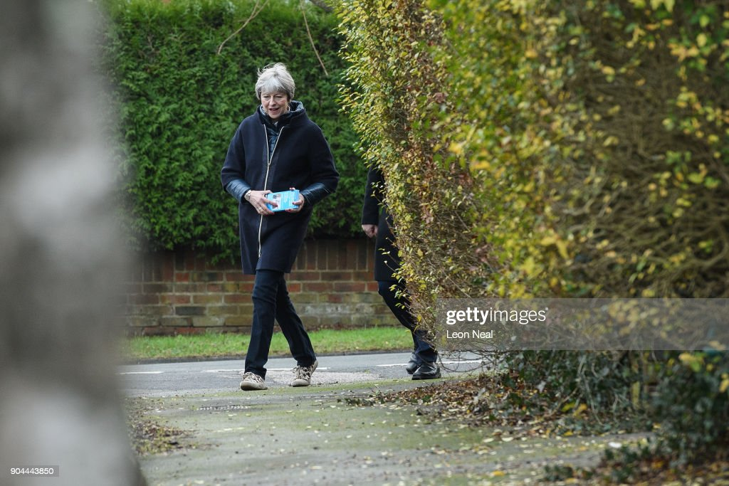 British Prime Minister Theresa May joins MP for Sutton and Cheam Paul Scully (not pictured) as he campaigns for the vote in the London local elections in May, on January 13, 2018 in London, England.