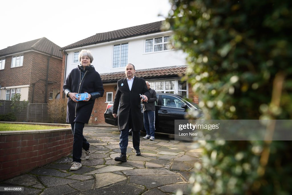 British Prime Minister Theresa May joins MP for Sutton and Cheam Paul Scully (R) as he campaigns for the vote in the London local elections in May, on January 13, 2018 in London, England.