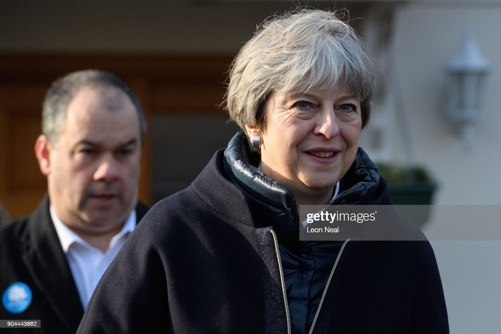 British Prime Minister Theresa May joins MP for Sutton and Cheam Paul Scully (L) as he campaigns for the vote in the London local elections in May, on January 13, 2018 in London, England.