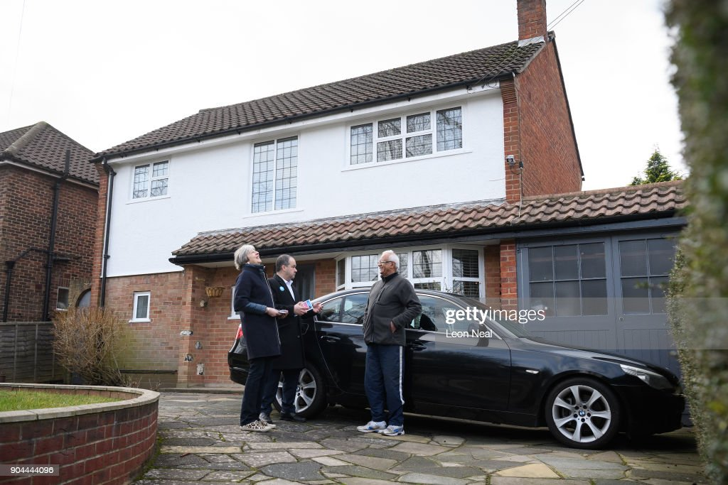 British Prime Minister Theresa May (L) joins MP for Sutton and Cheam Paul Scully (C) as he campaigns for the vote in the London local elections in May, on January 13, 2018 in London, England.