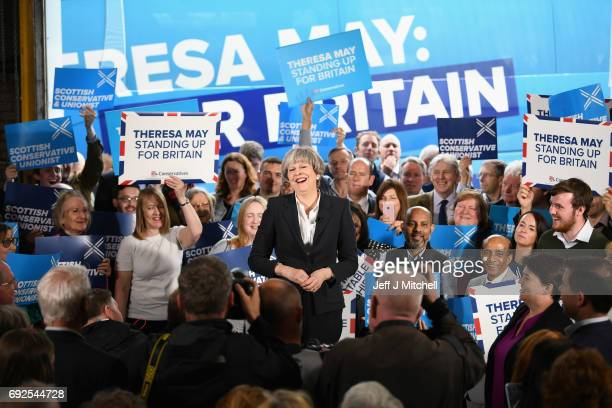 British Prime Minister Theresa May laughs as she delivers a speech at Clockwork Removals as the Conservative election campaign resumes on June 5 2017...