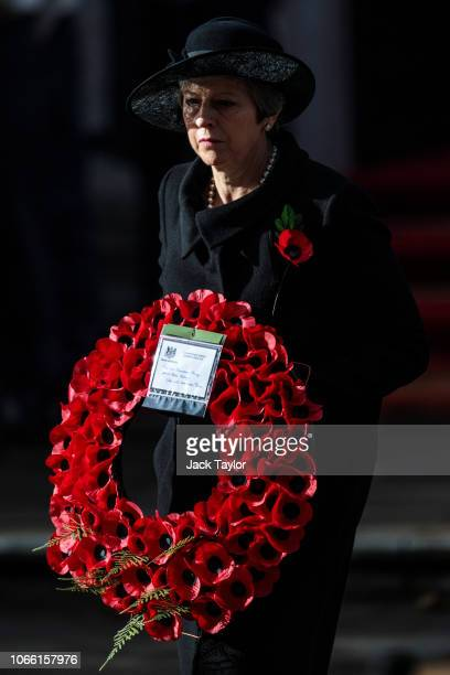 British Prime Minister Theresa May lays a wreath during the annual Remembrance Sunday memorial at the Cenotaph on Whitehall on November 11 2018 in...