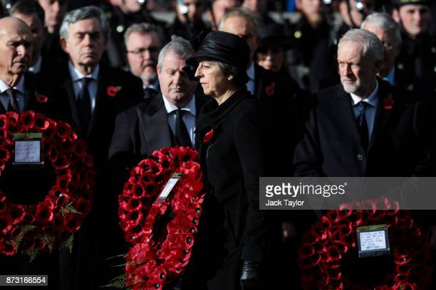 British Prime Minister Theresa May lays a wreath during the annual Remembrance Sunday memorial on November 12 2017 in London England The Prince of...