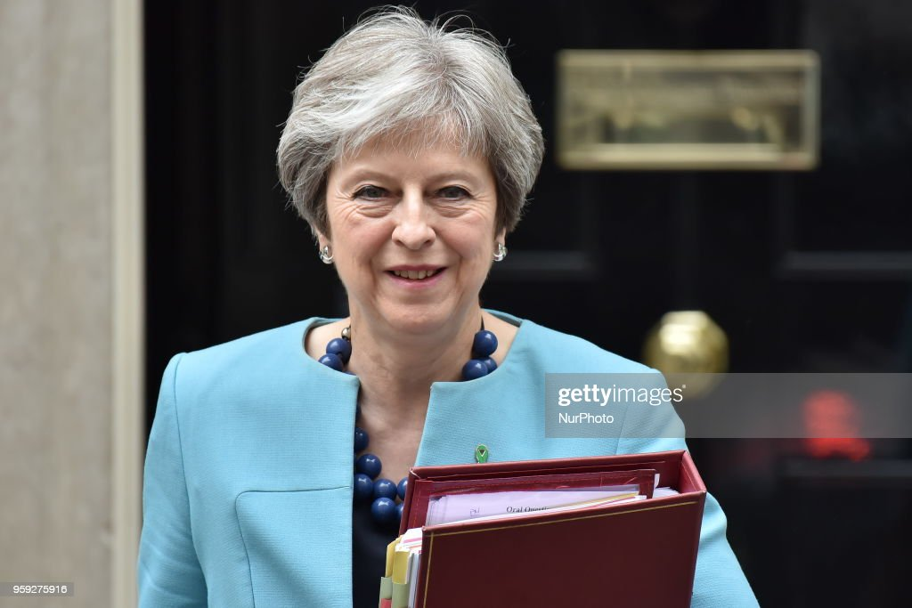 British Prime Minister Theresa May leaves 10 Downing Street as she heads to the Parliament to attend the weekly Prime Minister Questions session (PMQs), London on May 16, 2018.