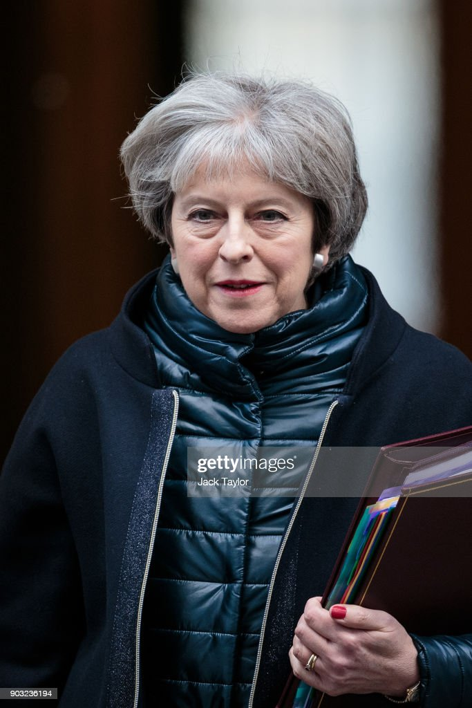 British Prime Minister, Theresa May leaves 10 Downing Street for Prime Minister's Questions on January 10, 2018 in London, England. Mrs May will hold her first Prime Ministers Questions of 2018 today which follows the reshuffling of her Cabinet yesterday.