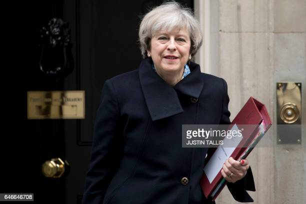British Prime Minister Theresa May leaves 10 Downing Street for the weekly Prime Minister's Questions session at the House of Commons in central...