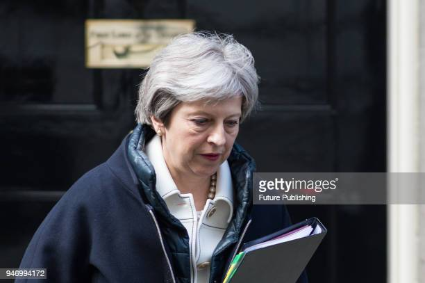 British Prime Minister Theresa May leaves 10 Downing Street for the House of Commons to make a statement on recent airstrikes launched against Syria...