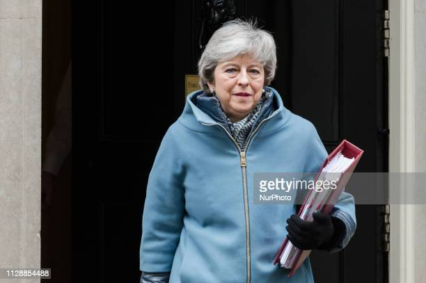 British Prime Minister Theresa May leaves 10 Downing Street in central London for the weekly PMQ session in the House of Commons on 06 March 2019