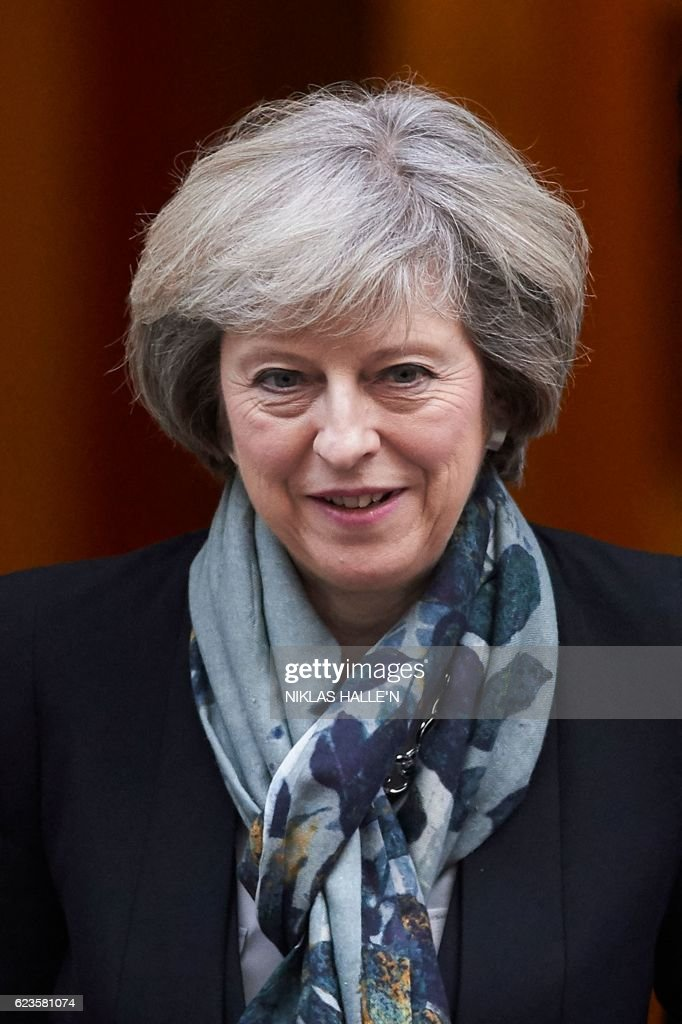 British Prime Minister Theresa May leaves 10 Downing Street in London on November 16, 2016, ahead of the weekly Prime Minister's Questions (PMQs) in the House of Commons. The British government insisted on November 16 that it has a plan for Brexit, after a leaked memo prepared by a consultancy firm warned it could take another six months to agree its negotiating strategy. N