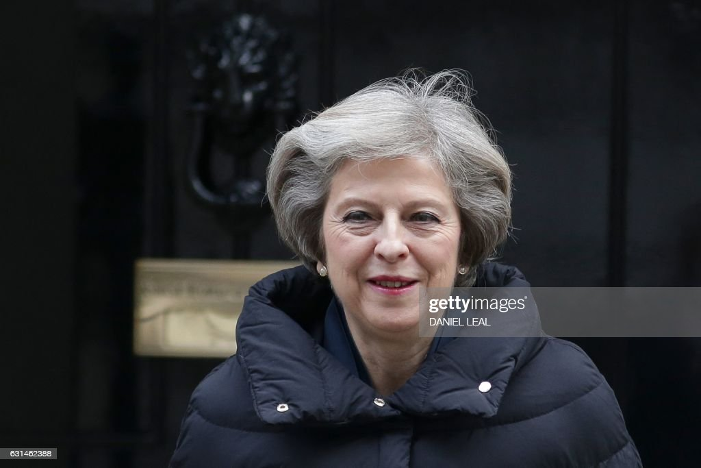 British Prime Minister Theresa May leaves 10 Downing Street in central London on January 11, 2017 to attend the weekly Prime Ministers Questions session in the House of Commons. / AFP / Daniel LEAL