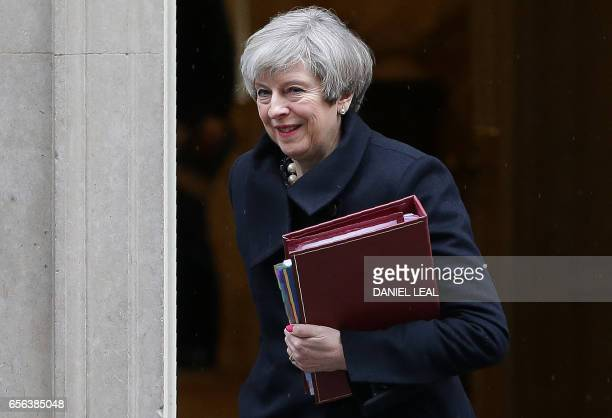 British Prime Minister Theresa May leaves 10 Downing Street in central London on March 22 to attend the weekly Prime Minister's Questions at the...