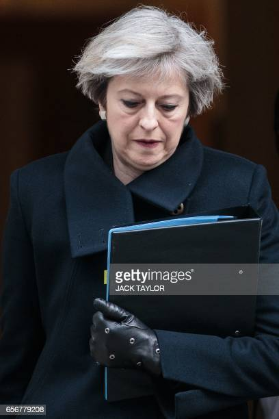 British Prime Minister Theresa May leaves 10 Downing Street in central London on March 23 2017 Britain's parliament reopened on Thursday with a...