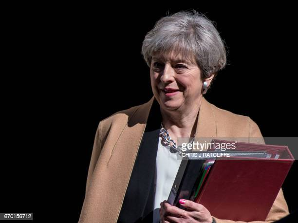 British Prime Minister Theresa May leaves 10 Downing Street in central London on April 19 2017 ahead of the weekly Prime Minister's Questions session...