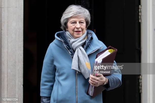 British Prime Minister Theresa May leaves 10 Downing Street to attend the weekly Prime Ministers Questions on January 9 2019 in London England The...