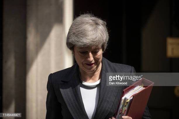 British Prime Minister Theresa May leaves 10 Downing Street to attend the weekly Prime Ministers Questions at the House of Commons on May 22, 2019 in...