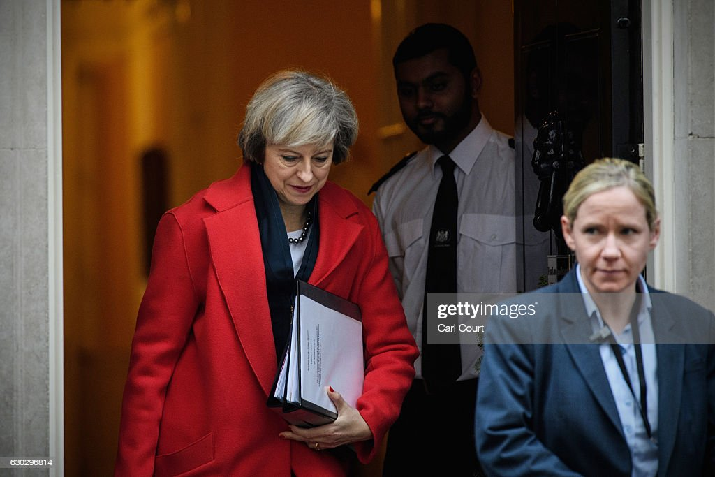 British Prime Minister Theresa May leaves 10, Downing Street to attend a Housing Select Committee on December 20, 2016 in London, England. Mrs May has sent a message of condolence to German Chancellor Angela Merkel following the Berlin lorry attack in which 12 people were killed.