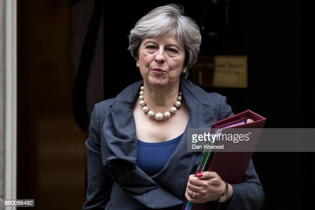 British Prime Minister Theresa May leaves 10 Downing Street to attend the weekly Prime Ministers Questions on October 11 2017 in London England