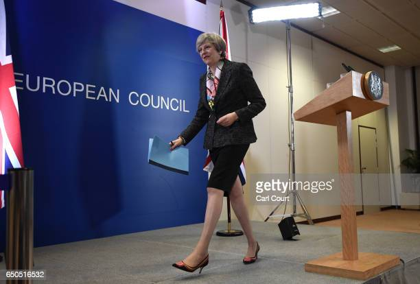 British Prime Minister Theresa May leaves after a press conference at the Council of the European Union on the first day of an EU summit on March 9...